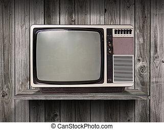 old television on wood shelf background