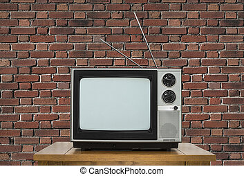 Old Television on Wood Table with Brick Wall