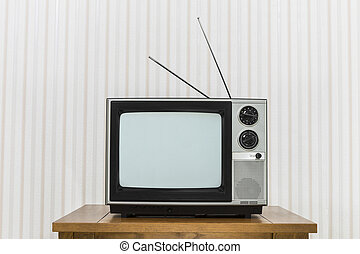 Old Television with Antenna on Wood Table.