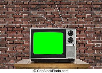 Old Television with Chroma Key Green Screen and Brick Wall