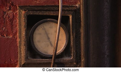 Old temperature gage - A steady shot of temperature gauge of...