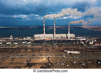 Old thermoelectric plant with big chimneys in a rural landscape