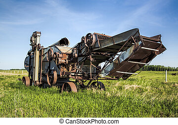 Old Threshing Machine - An old threshing machine rusts away...