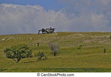 Old threshing machine on hilltop