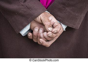Old Tibetan man hand in Lamayuru Gompa, , Ladakh, India.