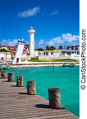 old tilted and new lighthouses in Puerto Morelos near...