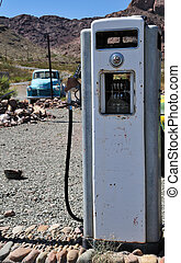 old time prices - old time vintage gas pump in the middle of...