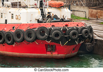 Old tires on bow ship.