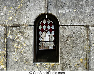 Old Tomb With Broken Windows - Close up of a family tomb in...