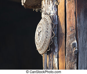 old tool hanging on the hut