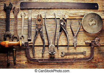old tools on a dark wood background. tinting. selective ...