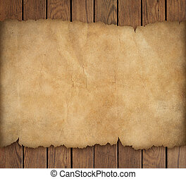 Old torn paper on wooden background