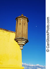 old tower of yellow walls in Elvas, Portugal