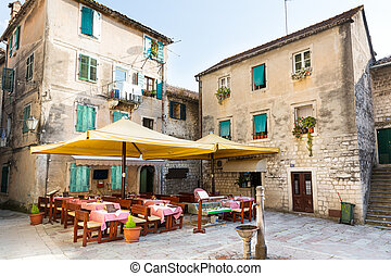 Old town cafe in street