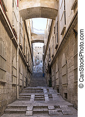 old town cobbled street in ancient jerusalem city israel