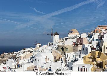Old Town of Oia on the island Santorini, white houses, ...