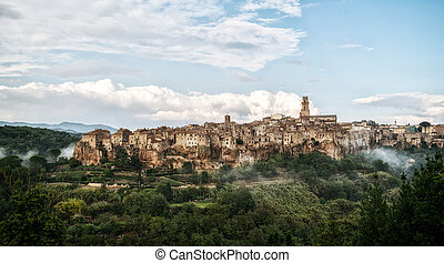 Panoramic view of the historic hilltop village of Pitigliano, Grosseto, Tuscany, Italy.