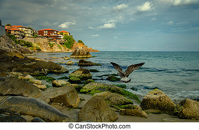old town on a rock cliff at seashore