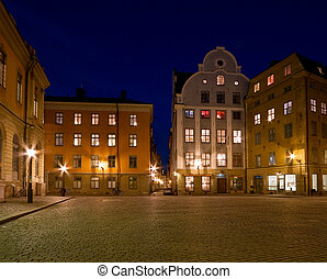Old town square at night.