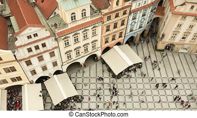 Old Town square with its gothic buildings and towers as an aerial  timelapse