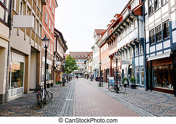 Old town street in the town of Goettingen, Lower Saxony, Germany. Numerous shops. Cobblestone street