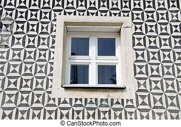 window on ornamental wall