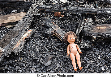 Old toy doll in the midst of ruins and devastation