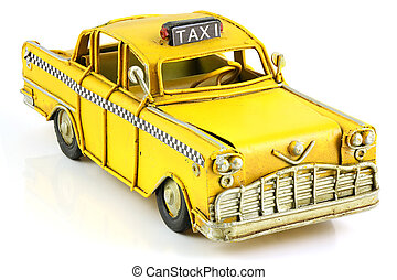 Old toy yellow taxi