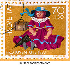 Old toys Doll - SWITZERLAND - CIRCA 1983: stamp printed by...