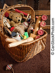 Old toys in a basket - Old basket filled with antique wooden...
