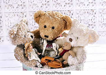 old toys in the box - old teddy bears and other toys in...