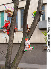 old toys on a tree near the house