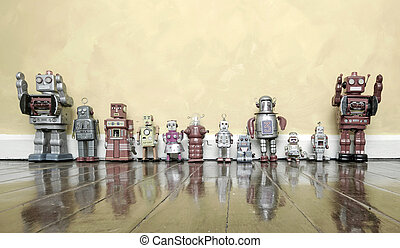 old toys  - retro robot toys on a wooden floor