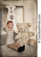 old toys - A doll and a teddy bear sitting next to eachother...