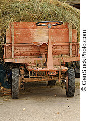 old tractor filled with straw