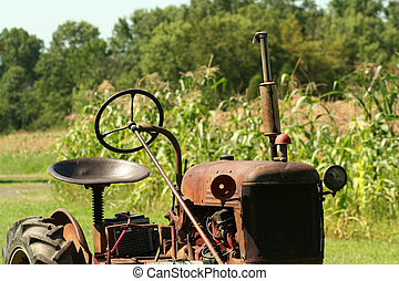Old Tractor on the edge of a corn field