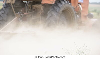 Old tractor plowing field. Slow Motion - Old tractor plowing...