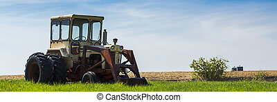 Old Tractor - The old tractor parked by the field