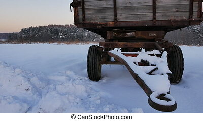 Old tractor wagon. Winter
