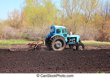old tractor with plough