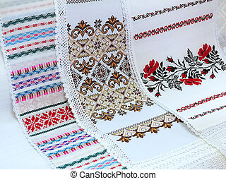 Old traditional balkan handmade floral embroidery on white canvas