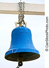 Old traditional bell hanging outside an orthodox church in Greece