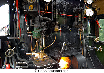 Details of a Steam Engine Footplate and Controls and Burner Stoked ready for the off