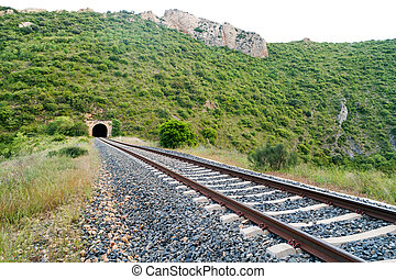 Old train tunnel with railway