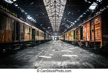 Old trains at abandoned train depot - Some trains at...