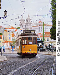 Traditional Yellow Tram on the street of Lisbon, Portugal
