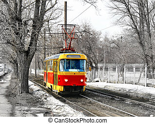 Old red and yellow tram over monochrome dull scenery