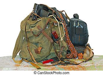 old traveller equipment. backpack, passport, map, camera ets