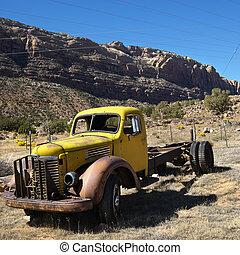 Old truck in desert.