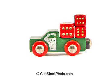 old truck toy with three red dice isolated on white